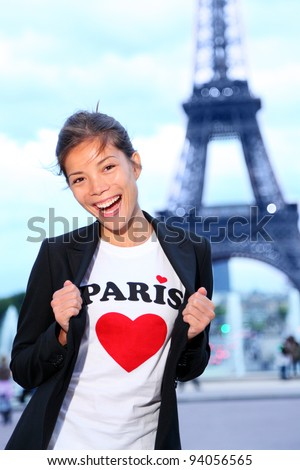 Paris Eiffel tower woman happy and excited in front of the Eiffeltower, Paris, France. - stock photo