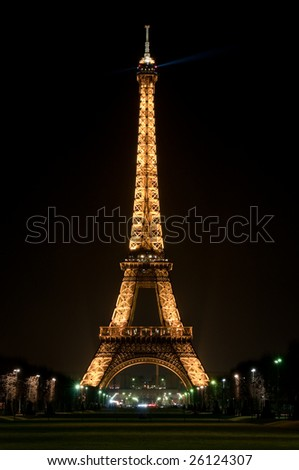 PARIS - FEBRUARY 27: The Eiffel Tower at night on February 27, 2009 in Paris. Eiffel Tower from the neighborhood.The metal structure of the Eiffel Tower weighs 7,300 tonnes. - stock photo