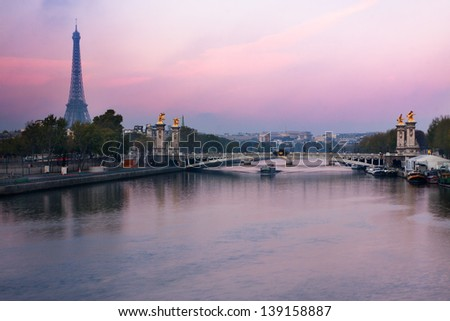 Paris, France - Alexandre III  bridge and Eiffel Tower at sunrise - stock photo