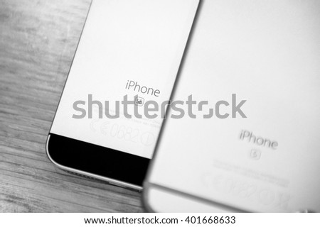 PARIS, FRANCE - APR 4, 2016: Comparing iPhone 6S next to the new Apple iPhone SE during the sales launch of the latest Apple Inc. smartphone and iPad Pro at the Apple store in Paris, France - stock photo