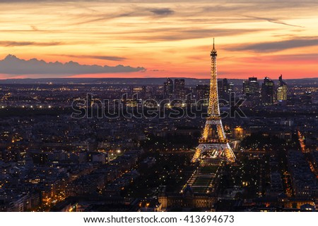 PARIS, FRANCE- APRIL 14, 2016: Aerial view of Eiffel Tower with light performance show. Eiffel Tower is the famous landmark of Paris. - stock photo
