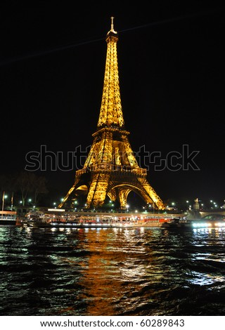 PARIS, FRANCE-  APRIL 4: Eiffel tower at night. The Eiffel tower is the most visited monument of France. April 4, 2010 - stock photo