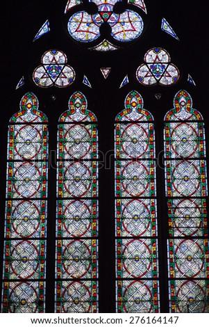 PARIS, FRANCE - APRIL 08, 2013: Famous Notre Dame cathedral stained glass. Paris, France on April 08, 2013 - stock photo