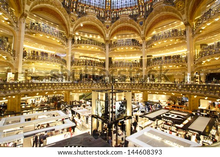 PARIS, FRANCE - APRIL 24 : inside part of the famous Galeries Lafayette with it's brand stands stalls such as Chanel and Lancome on April 24th 2013 in Paris, France - stock photo