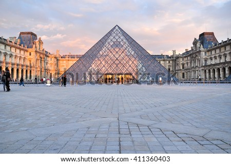 PARIS, FRANCE - APRIL 8, 2016: Louvre Pyramid at Louvre Museum is one of famous museum and  the most visited museum in the world - stock photo