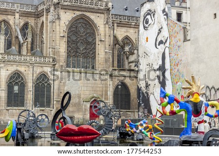 PARIS, FRANCE -  APRIL 26:Stravinsky Fountain 16 works of sculpture, moving and spraying water, representing works of composer Igor Stravinsky near Pompidou museum on april 26, 2013 in Paris. - stock photo