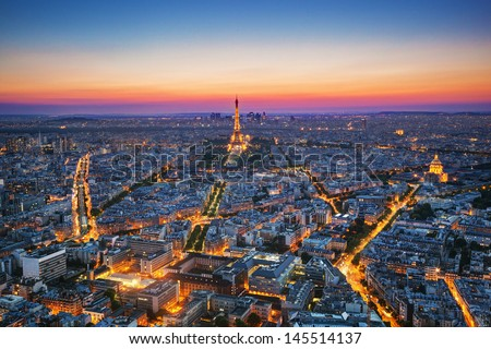 Paris, France at sunset. Aerial view on the Eiffel Tower, Arc de Triomphe, Les Invalides etc. - stock photo