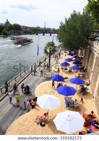 PARIS, FRANCE - AUG. 08:THE BEACH IN THE CITY AT PARIS (PLAGES) on August 08. 2015 in Paris, France. The Paris Plages (Paris Beaches) operation kicks off from 19 July to 17 August - stock photo