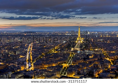 PARIS, FRANCE - AUGUST 28: Aerial view of illuminated Eiffel Tower at night on August 28, 2015 in Paris, France - stock photo