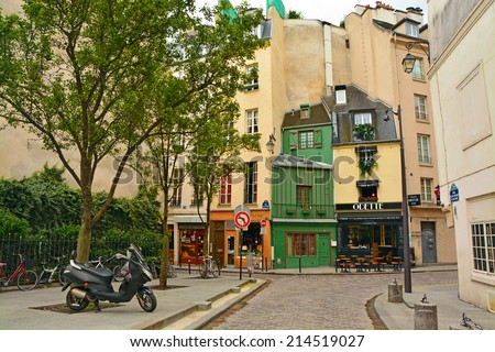 PARIS, FRANCE - August 18: Latin Quarter of Paris, France on August 18. 2014. Narrow cobbled street among old traditional parisian houses in Paris. - stock photo