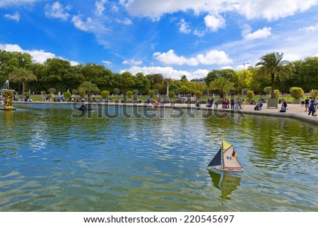 PARIS, FRANCE, August 9, 2014: Luxembourg Palace and octagonal basin. The Jardin du Luxembourg is the second largest public park in Paris, France. The park is the garden of the French Senate - stock photo