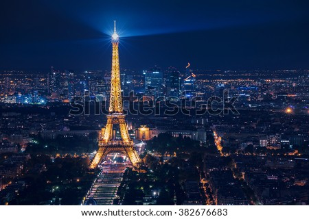 PARIS, FRANCE - AUGUST 29 2015: Night scene of illuminated Eiffel Tower and panoramic aerial view of Paris, France  - stock photo