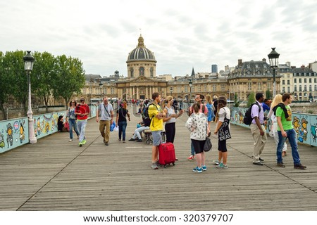 PARIS, FRANCE - AUGUST 09, 2015: Paris streets. Paris, aka City of Love, is a popular travel destination and a major city in Europe - stock photo