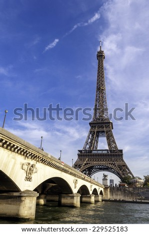 PARIS, FRANCE, August 7, 2014: Paris, the beautiful view of the Eiffel Tower and and Jena bridge on a sunny day  - stock photo