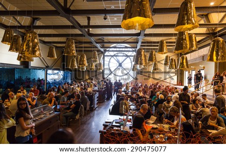 Paris, France - August 10, 2014: Restaurant with famous ancient clock window in Orsay Museum is full with visitors and personnel - stock photo