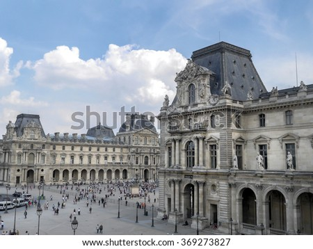 PARIS, FRANCE - AUGUST 28 2013: - The main courtyard of the Louvre Museum - stock photo