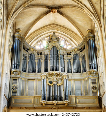 PARIS, FRANCE - AUGUST 12, 2014: The pipe organ in the catholic church of Saint Germain of Auxerre in Paris, France. Paris is one of the most popular tourist destinations in Europe. - stock photo