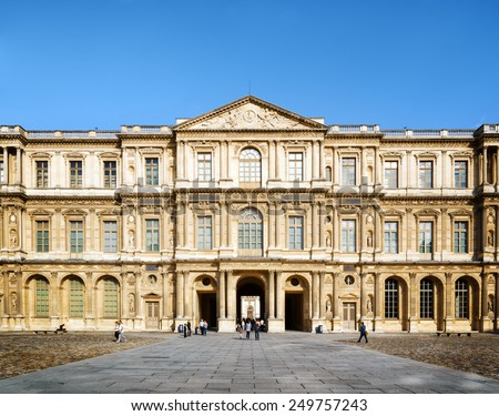 PARIS, FRANCE - AUGUST 13, 2014: The view of the eastern facade of the Louvre from courtyard. Tourists enter through the east gate of the palace. - stock photo