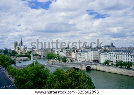 PARIS, FRANCE, AUGUST 6, 2013: view of the city from the Arab World Institute - stock photo