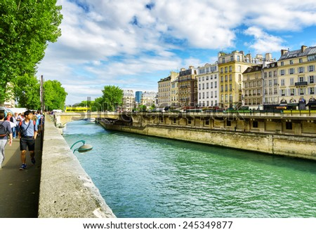 PARIS, FRANCE - AUGUST 12, 2014: View of the Little Bridge. The bridge over the River Seine in Paris has existed on this spot since early history. - stock photo
