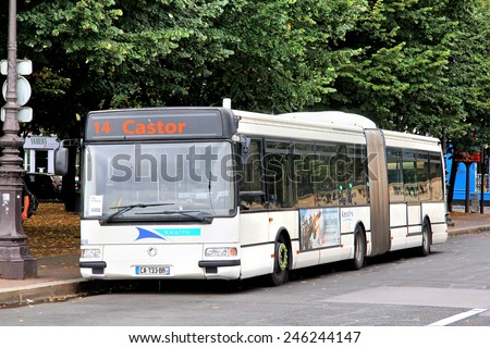 PARIS, FRANCE - AUGUST 8, 2014: White articulated city bus Renault Agora L at the city street. - stock photo