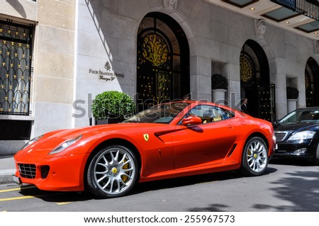 PARIS, FRANCE - CIRCA JULY 2009: A Ferrari 599 GTB Fiorano parked in front of the George V Hotel in Paris - stock photo