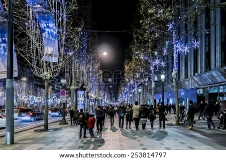 PARIS, FRANCE - 22 DECEMBER, 2014: Christmas illumination at Avenue Champs-Elysees. Champs-Elysees is one of the most famous streets in the world. - stock photo
