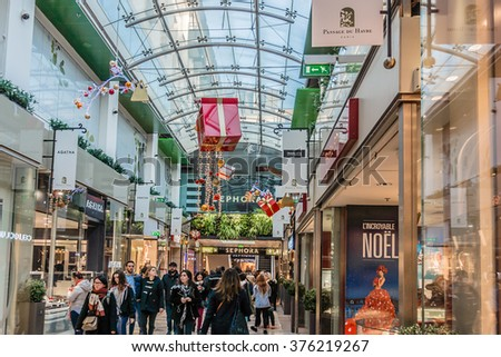 PARIS, FRANCE - DECEMBER 31, 2015: Passage du Havre is one of covered passages in Paris, was rebuilt in 1990s as a modern mall: currently offers a great choice of clothing brands and decoration shops. - stock photo