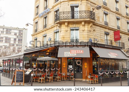 Paris, France - December 22, 2014: Traditional Parisian street cafe Odessa.  Located not far from the Montparnasse Tower. - stock photo