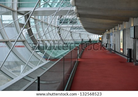 PARIS, FRANCE - DECEMBER 31, 2010: Walkway leading toward boarding gates of terminal 2E at Charles de Gaulle Airport. - stock photo