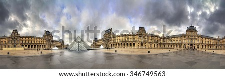 PARIS, FRANCE - FEBRUARY 19, 2014: Beautiful 360 degree view of the Louvre museum in Paris, France, on February 19, 2014 - stock photo