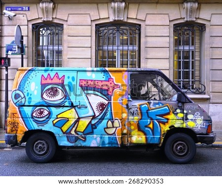 PARIS, FRANCE -26 FEBRUARY 2015- Editorial: Paris has become one of the European capitals for graffiti street art. Many delivery trucks are spray painted with colorful graffiti tags. - stock photo
