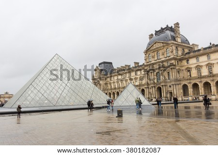 PARIS, FRANCE - FEBRUARY, 13, 2016: Louvre Museum on the stormy rainy day in a winter season - stock photo