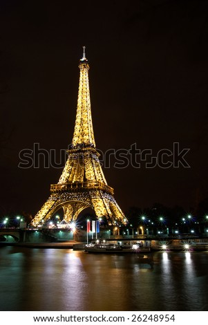 Paris, France, 2 February 2009: Night light show of the Eiffel tower. The Eiffel Tower is the most visited monument in France. The light show is on display every day at night at the hour. - stock photo