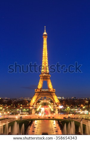 PARIS, FRANCE - FEBRUARY 21, 2014: The Eiffel tower at night seen from the Trocadero square in Paris, France, at February 21, 2014 - stock photo