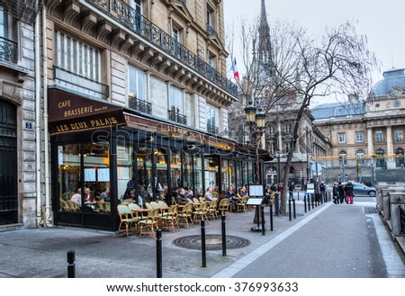 PARIS, FRANCE - FEBRUARY 05, 2016: Typical bar in the old town of Paris, France, Paris is one of the most populated metropolitan areas in Europe full of bars and cafes. - stock photo