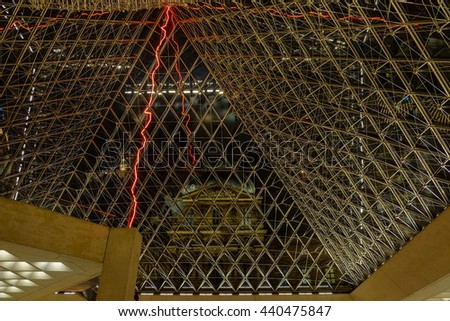 Paris,France - FEBRUARY 24,2016- View of the inside of the upper Louvre pyramid from below - stock photo