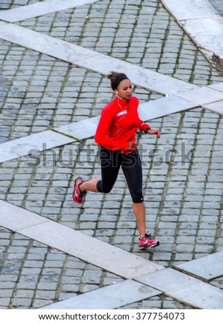 PARIS, FRANCE - FEBRUARY 07, 2016: Woman running on road for health near seine river - stock photo