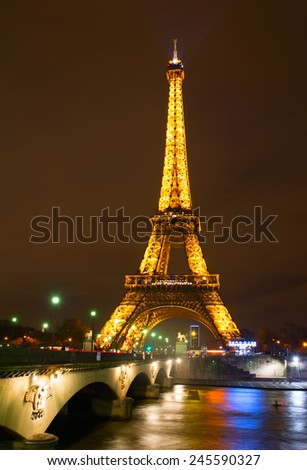 PARIS, FRANCE - JAN 18, 2015: Eiffel Tower at night in Paris. The Eiffel Tower stands 324 metres (1,063 ft) tall. Monument was built in 1889, night view of the Siene River  - stock photo