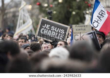 "PARIS, FRANCE - JANUARY 11, 2015 : Je suis Charlie -  Republican march in Paris against the terrorist attack on Charlie hebdo journal, people holding a sign ""Je suis Charlie"" in solidarity. - stock photo"