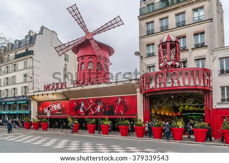 PARIS, FRANCE - JANUARY 1, 2016: Moulin Rouge. Moulin Rouge is a famous Parisian cabaret built in 1889, locating in Paris red-light district of Pigalle on Boulevard de Clichy. - stock photo