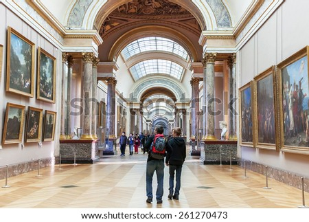 Paris, France - January 11, 2015: People are visiting, walking (inside ) the Louvre Museum. Louvre is one of the largest and famous museums in the world. It is the best destinations in Europe. Paris.  - stock photo