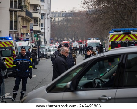 PARIS, FRANCE - JANUARY 7, 2015 Street of Paris after the  Terror attack in Paris at the Charlie Hebdo newspaper. - stock photo