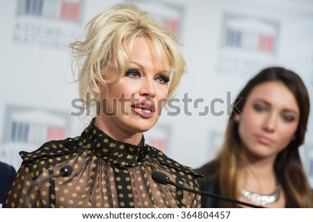 PARIS, FRANCE - JANUARY 19, 2016 : The canadian actress Pamela Anderson during the press conference against the force-feeding of geese at the french National Assembly. - stock photo