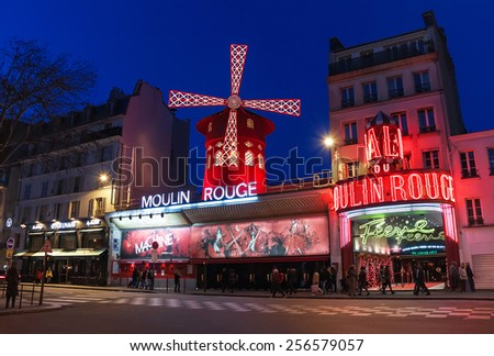 Paris, France - January 11, 2015: The Moulin Rouge by night. Paris. France. Moulin Rouge is a famous cabaret, locating in the Paris red-light district of Pigalle. Travel (vacation) concept. - stock photo