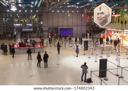 PARIS, FRANCE - JANUARY 4, 2012: Tourists in a lobby of The Pompidou Centre, one of the world's most popular cultural venues and one of the most visited monuments in France. - stock photo