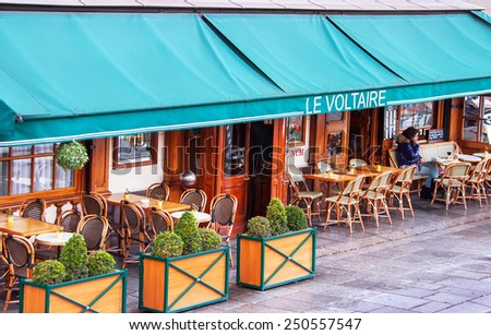 Paris, France - January 9, 2015. Traditional parisian cafe. Cafe le Voltaire named after the french writer Voltaire. It contained in the house, where  Voltaire lived. Travel, cuisine concept. France. - stock photo