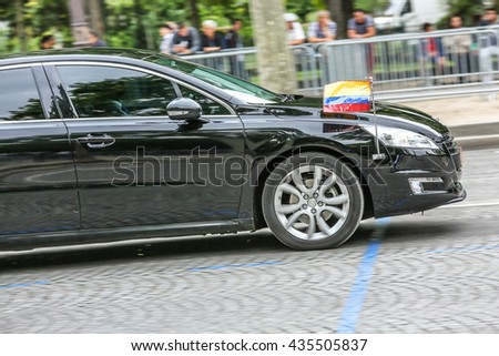 PARIS, FRANCE - JULY 14, 2014: Ecuador Diplomatic car during Military parade (Defile) in Republic Day (Bastille Day). Champs Elysees. - stock photo