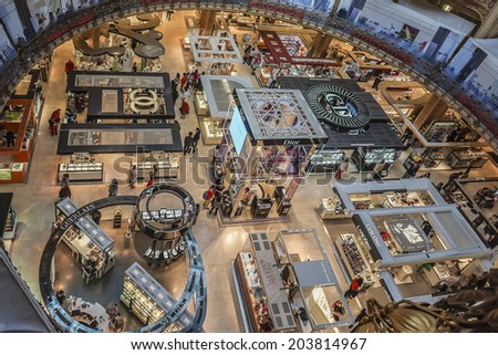 PARIS, FRANCE - JULY 15, 2012: Interior of Printemps in Paris - largest beauty Department Store in world with 45000 square meters of shopping. - stock photo