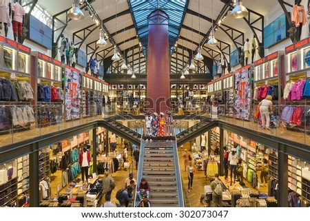 PARIS, FRANCE -8 JULY 2015- Japanese retailer UNIQLO opened in 2014 a new store in the historical building Societe des Cendres in the Marais neighborhood of Paris. - stock photo